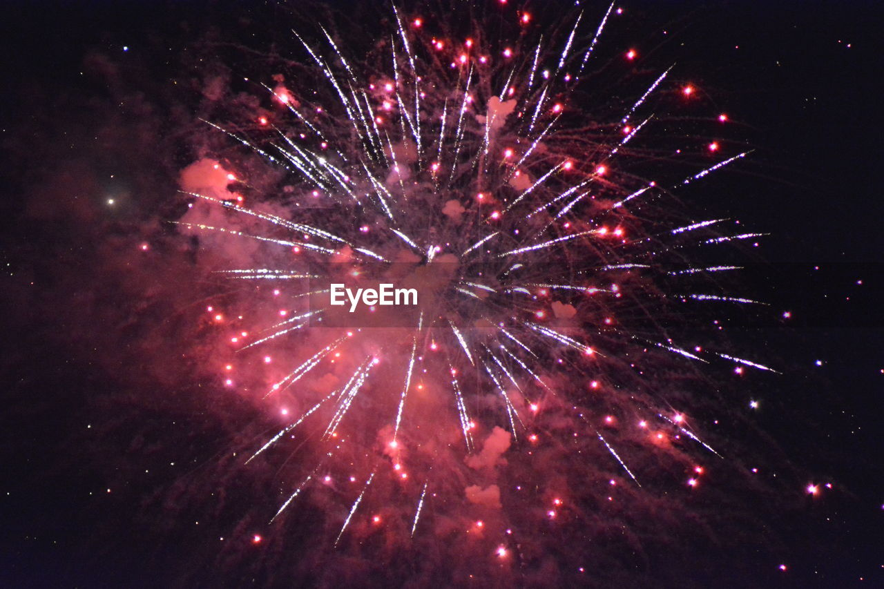 night, illuminated, firework display, firework, celebration, exploding, motion, long exposure, arts culture and entertainment, sky, event, no people, glowing, nature, red, low angle view, multi colored, firework - man made object, blurred motion, outdoors, light, sparks, explosive