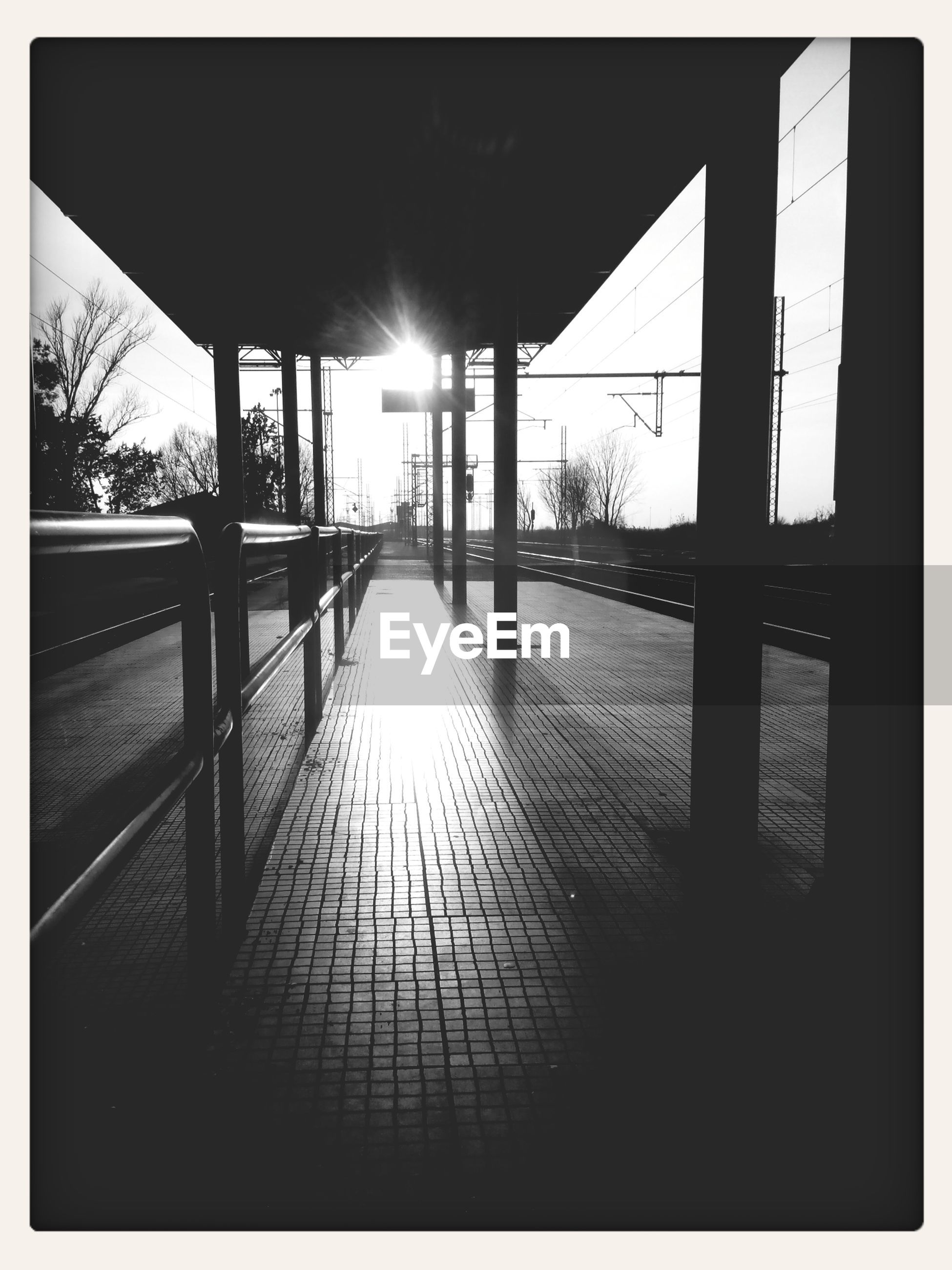 transfer print, auto post production filter, built structure, sunlight, architecture, indoors, railing, the way forward, empty, sun, sunset, absence, walkway, narrow, shadow, water, sunbeam, no people, long, dark