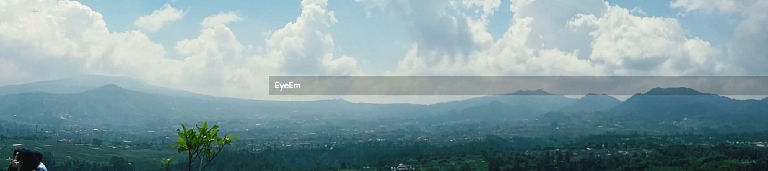 mountain, sky, mountain range, tranquil scene, landscape, scenics, tranquility, beauty in nature, cloud - sky, nature, cloud, tree, non-urban scene, idyllic, panoramic, day, outdoors, cloudy, blue, growth