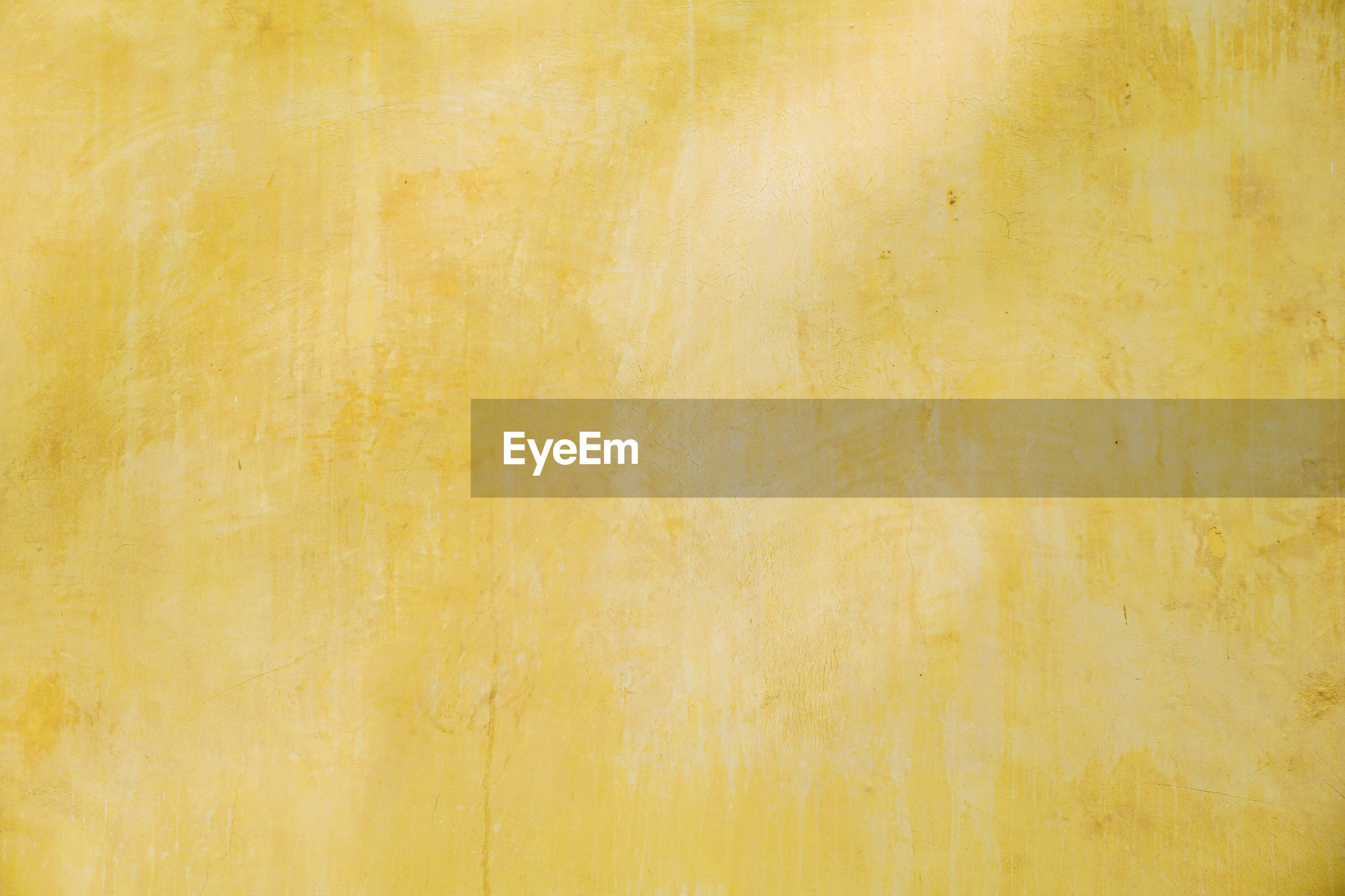 Concrete wall texture background, yellow painted