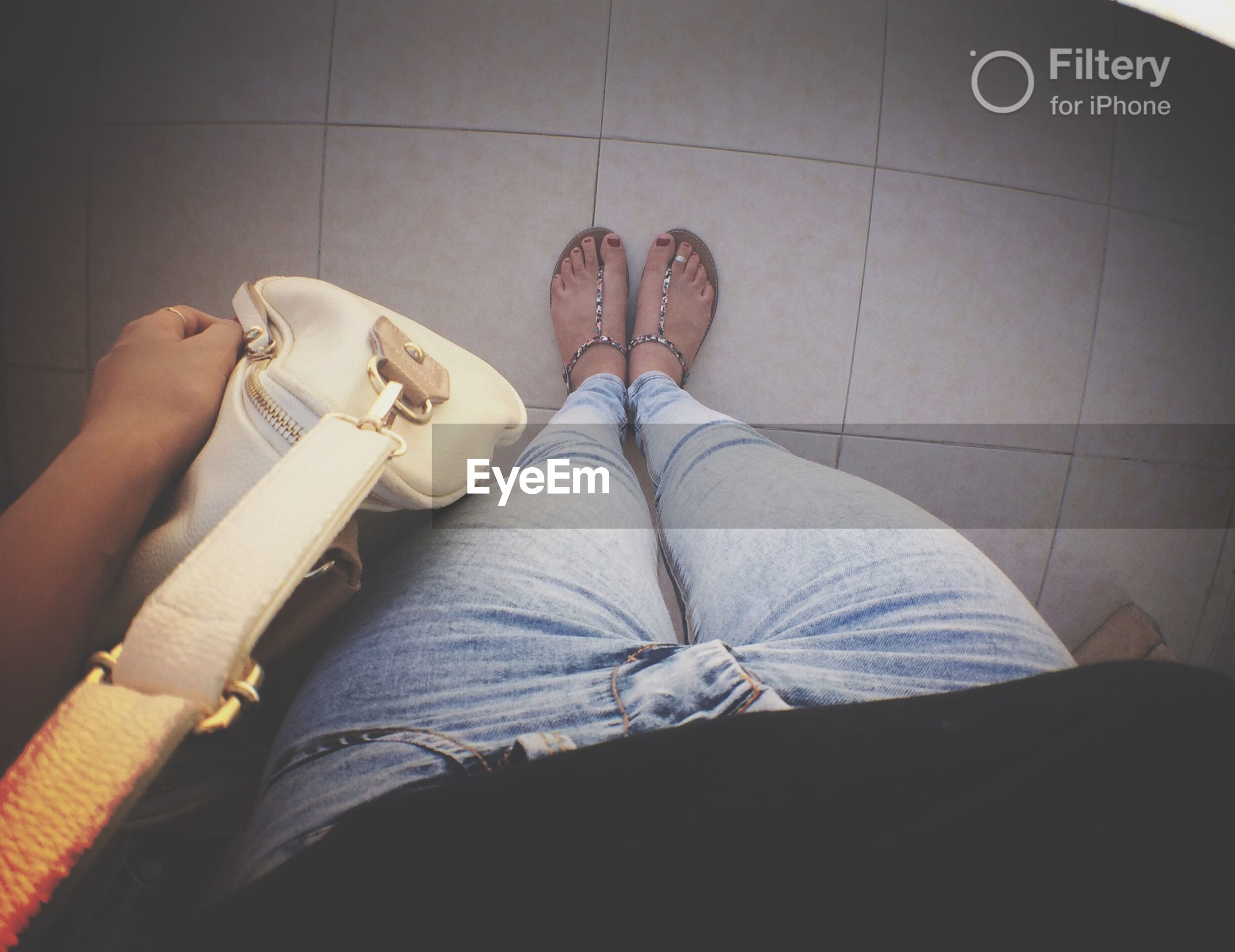 low section, person, indoors, lifestyles, shoe, personal perspective, men, standing, leisure activity, human foot, jeans, casual clothing, high angle view, sitting, communication, text