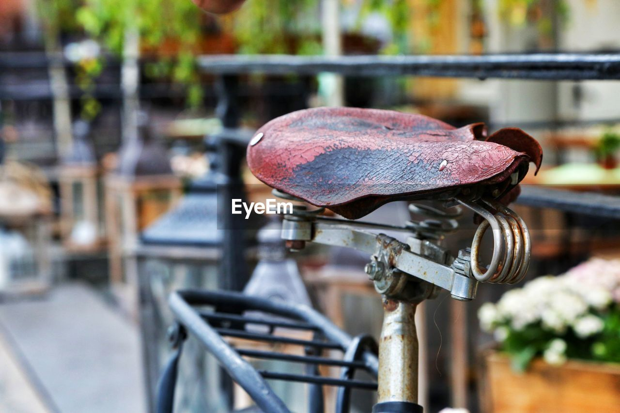 metal, focus on foreground, day, close-up, outdoors, bicycle, architecture, no people, railing, rusty, old, nature, built structure, transportation, table, wood - material, connection, selective focus, cafe, mode of transportation
