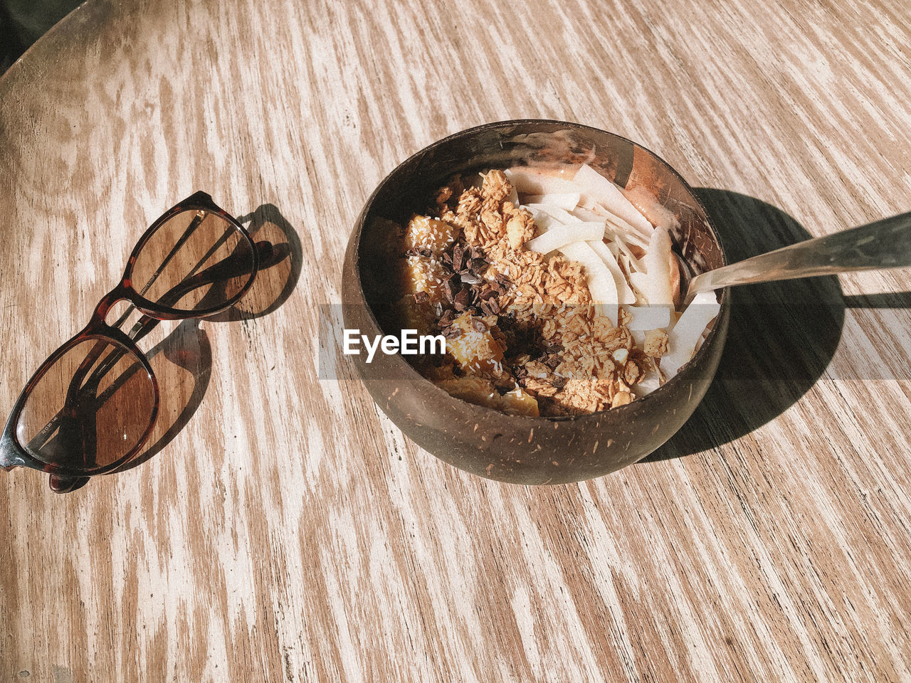 food and drink, food, table, spoon, wood - material, still life, kitchen utensil, eating utensil, dairy product, freshness, indoors, sweet food, bowl, ice cream, sweet, frozen food, no people, close-up, frozen, high angle view, breakfast, temptation