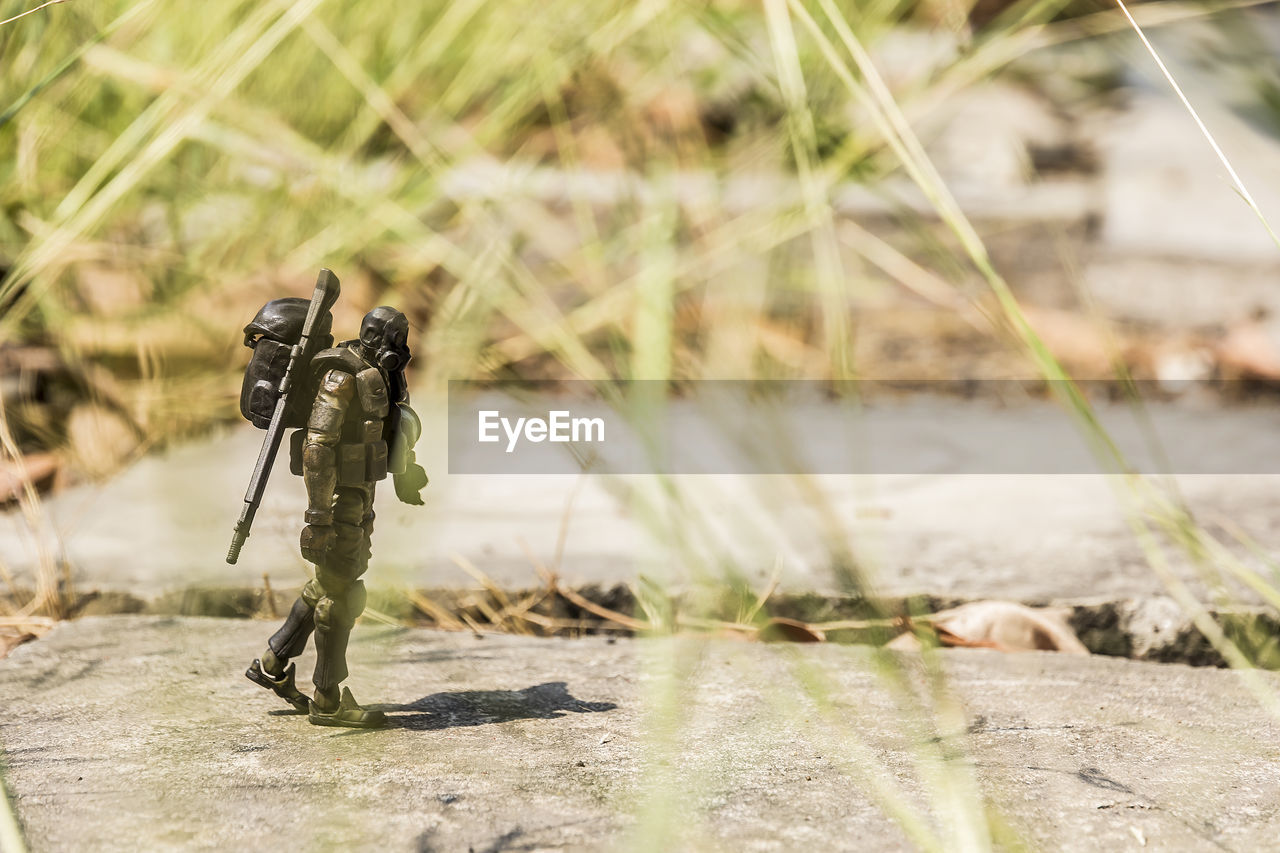nature, day, gun, sunlight, no people, focus on foreground, selective focus, outdoors, weapon, close-up, water, military, rifle, security, plant, technology, tripod, sport, aggression