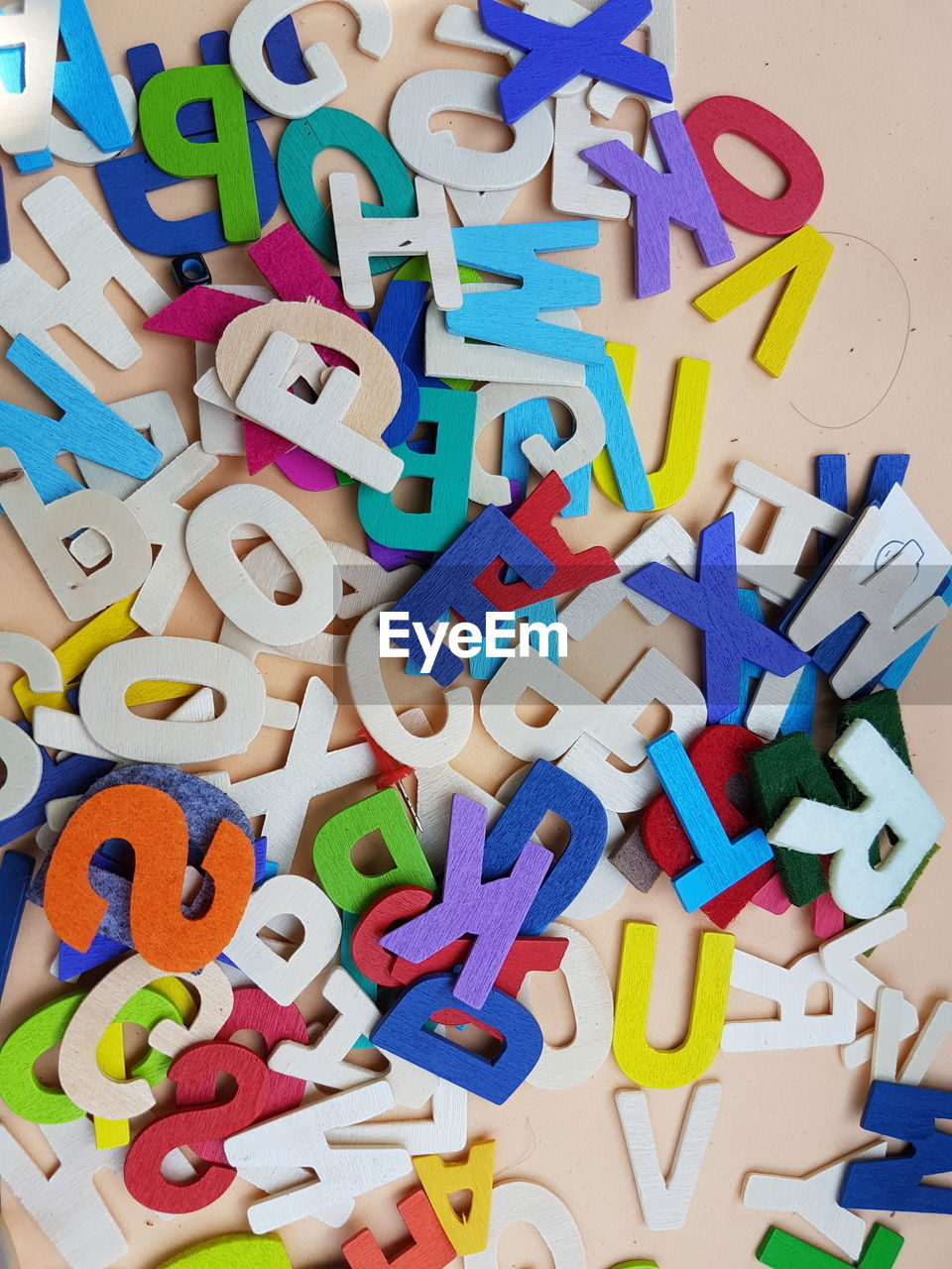 High Angle View Of Colorful Alphabets On Table
