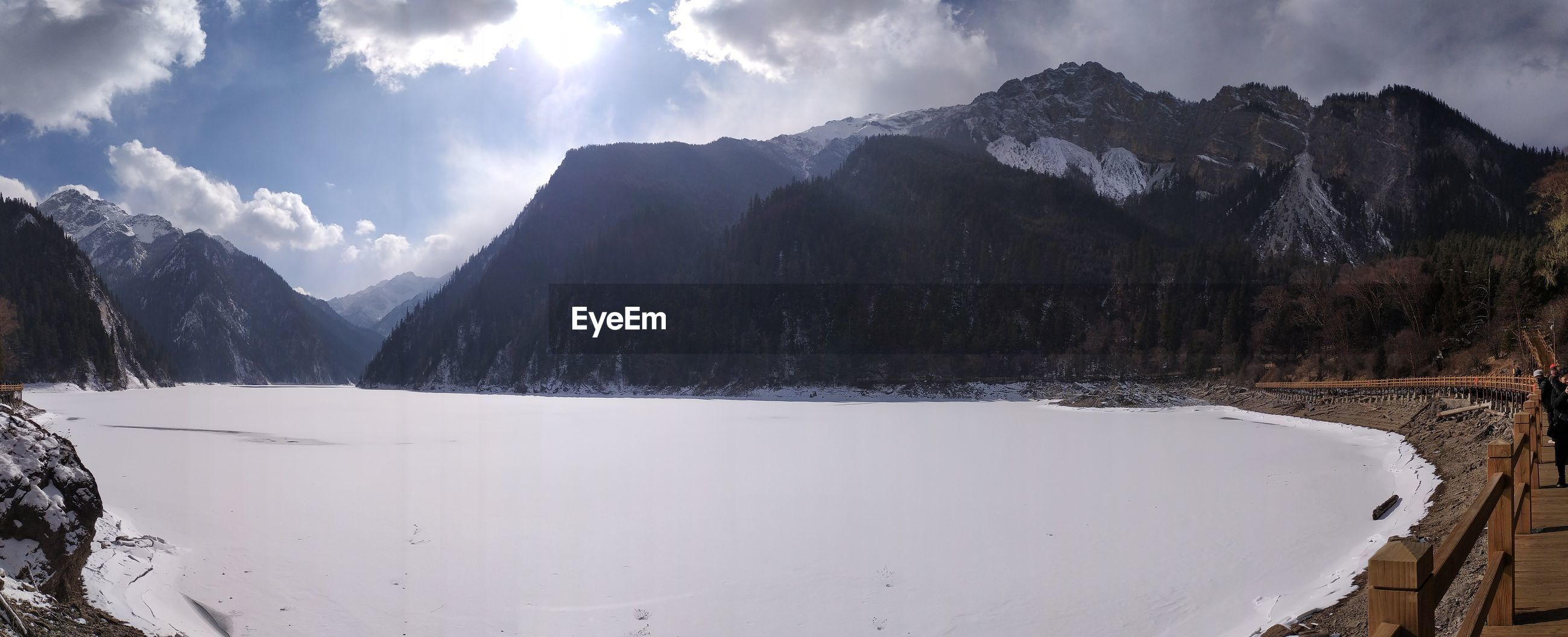 PANORAMIC VIEW OF SNOWCAPPED MOUNTAINS AGAINST SKY DURING WINTER