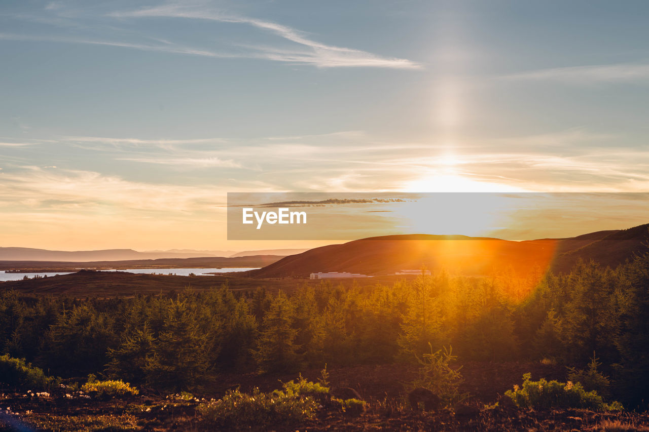 Scenic view of countryside landscape at sunset