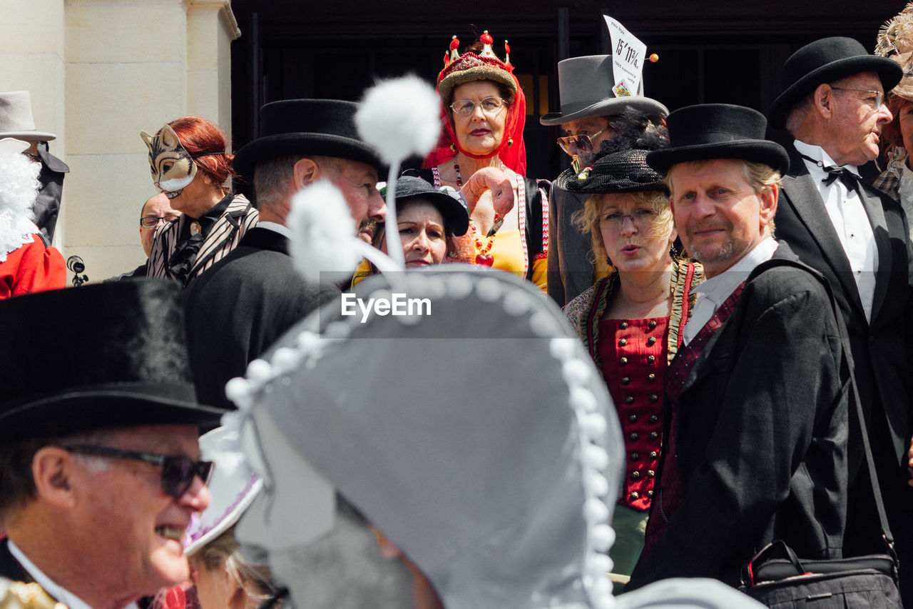 celebration, real people, costume, togetherness, men, young women, standing, medium group of people, young adult, young men, mature adult, lifestyles, women, outdoors, well-dressed, day, period costume