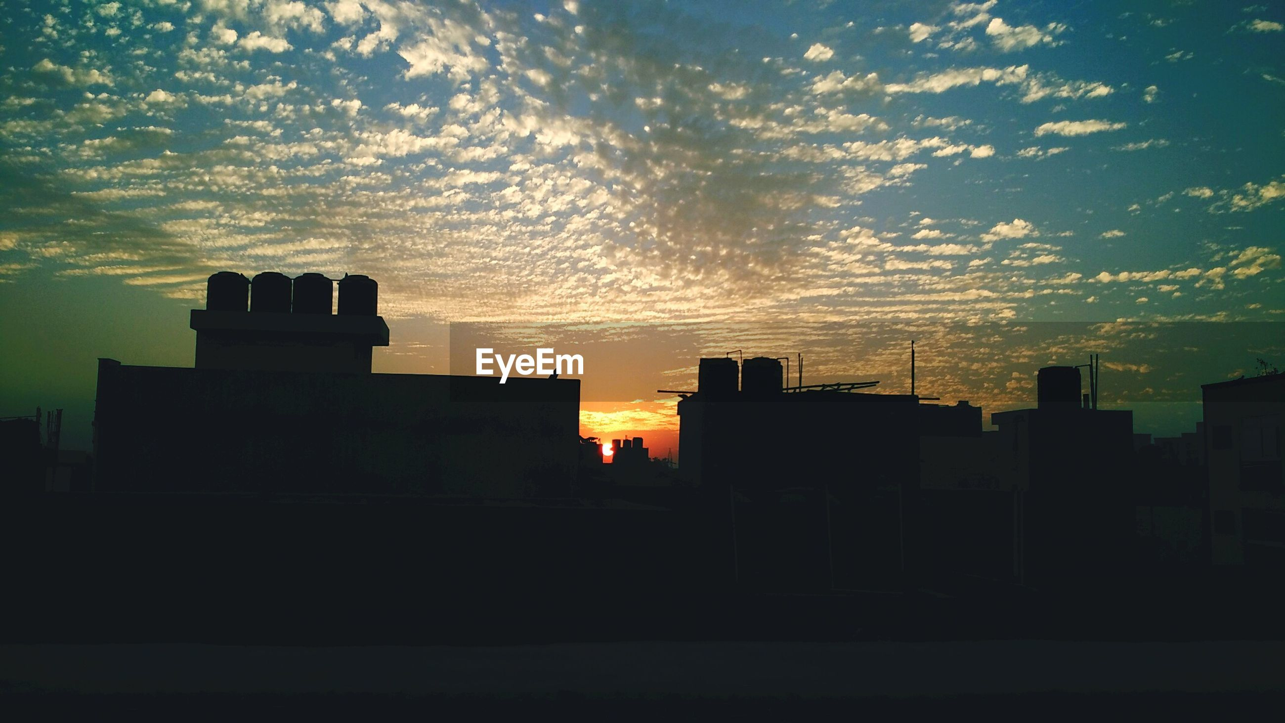 sunset, building exterior, architecture, silhouette, built structure, sky, city, cloud - sky, building, orange color, residential building, residential structure, house, dusk, cloud, dark, outdoors, no people, nature, sunlight