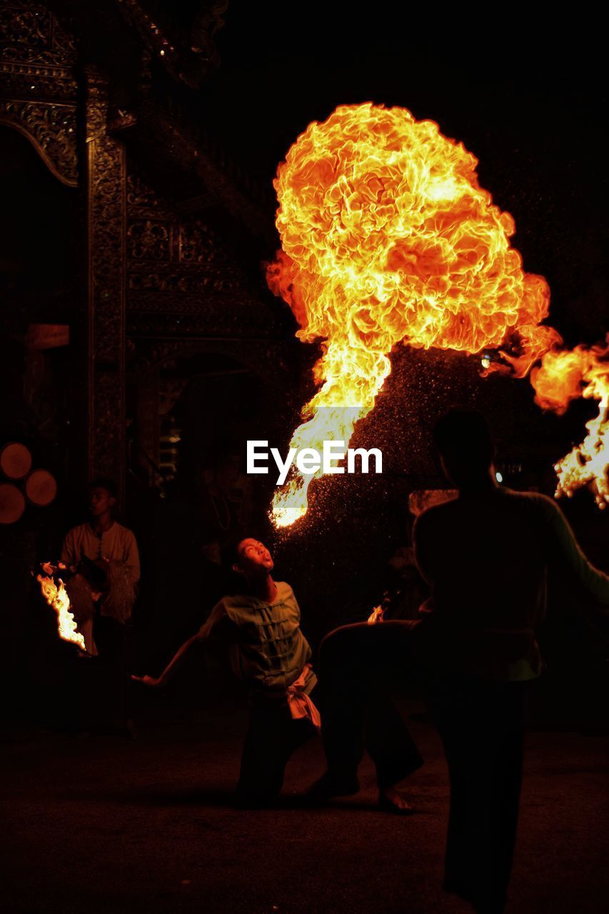 group of people, burning, night, flame, real people, fire, heat - temperature, fire - natural phenomenon, men, standing, arts culture and entertainment, people, performance, lifestyles, leisure activity, motion, adult, glowing, women, skill, outdoors, bonfire