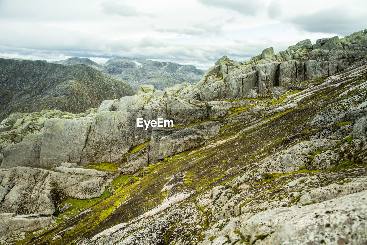 mountain, beauty in nature, sky, scenics - nature, cloud - sky, rock, environment, non-urban scene, tranquil scene, tranquility, landscape, mountain range, nature, day, no people, solid, rock - object, geology, physical geography, idyllic, outdoors, formation, eroded