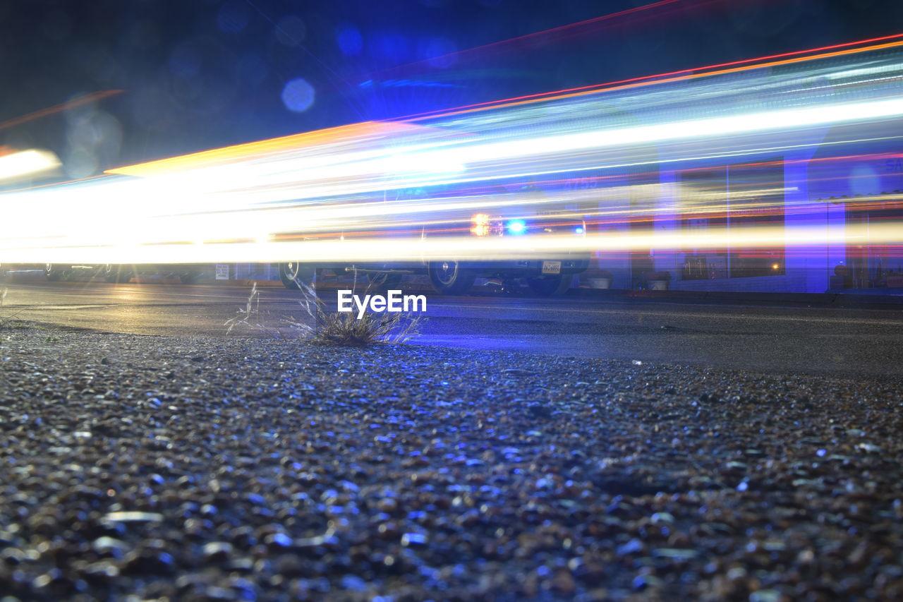 night, illuminated, speed, long exposure, light trail, motion, blurred motion, transportation, outdoors, road, city, stadium, no people, sky