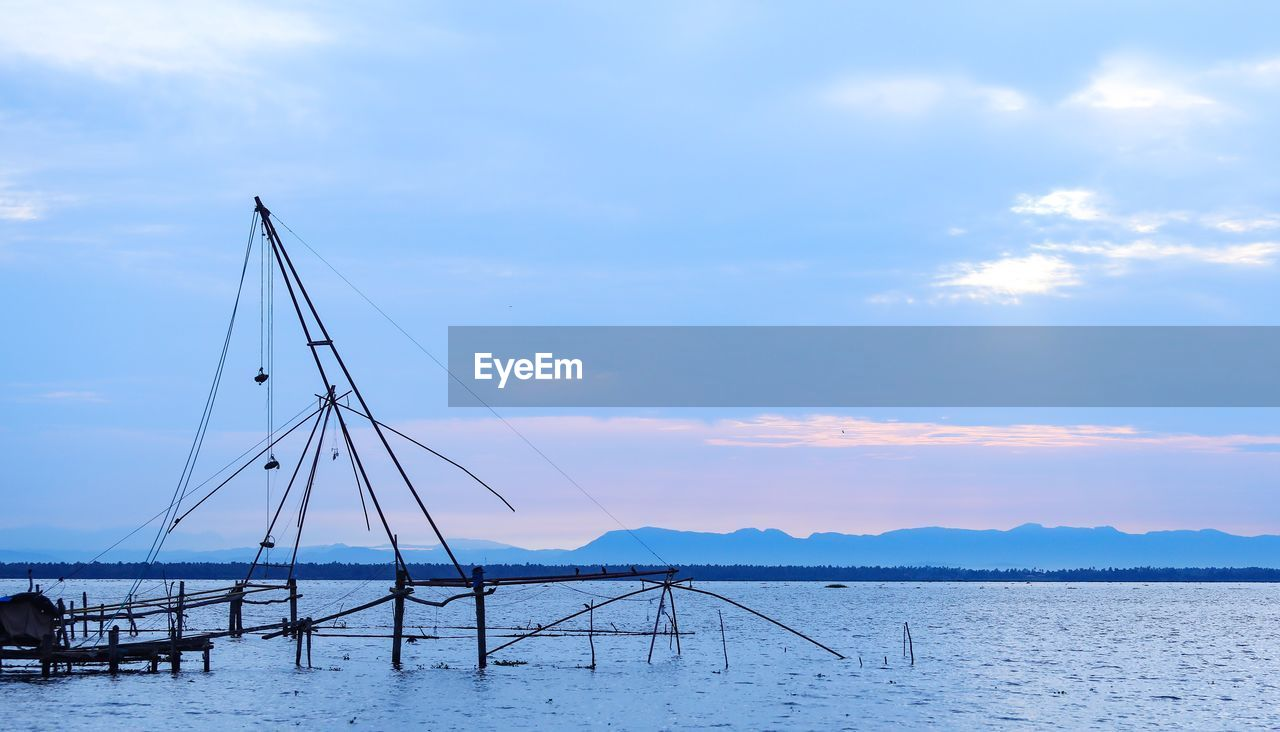 sky, cloud - sky, water, sea, beauty in nature, scenics - nature, waterfront, transportation, nature, no people, nautical vessel, tranquil scene, tranquility, day, sailboat, mode of transportation, non-urban scene, outdoors, idyllic, fishing industry