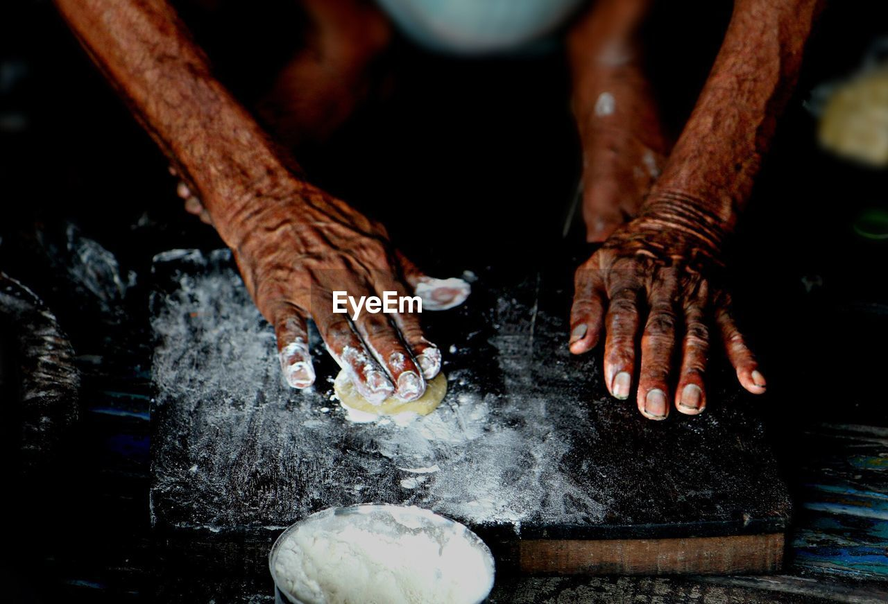 Cropped Image Of Man Making Chapatti