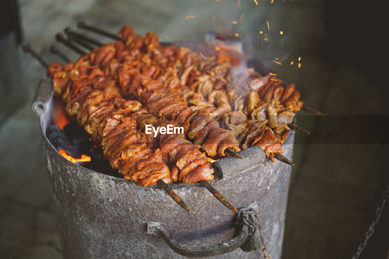 Close-Up Of Beef In Skewer On Burning Coal