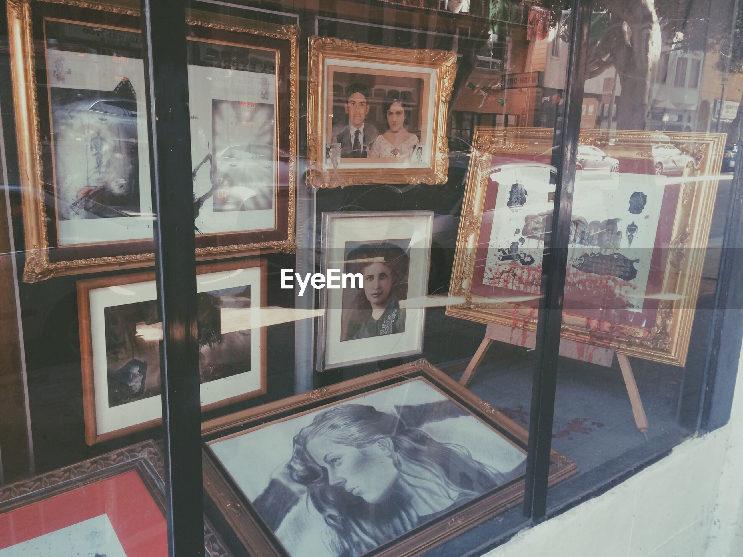 indoors, window, glass - material, built structure, architecture, art, transparent, reflection, store, art and craft, shelf, home interior, human representation, creativity, day, house, old, no people, retail, table