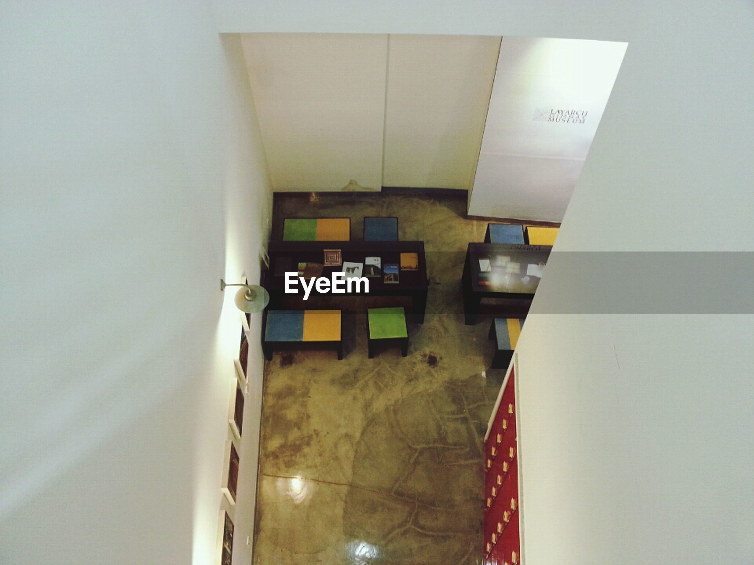 indoors, architecture, built structure, illuminated, ceiling, wall - building feature, interior, lighting equipment, wall, corridor, absence, building, empty, home interior, no people, house, door, reflection, modern, flooring