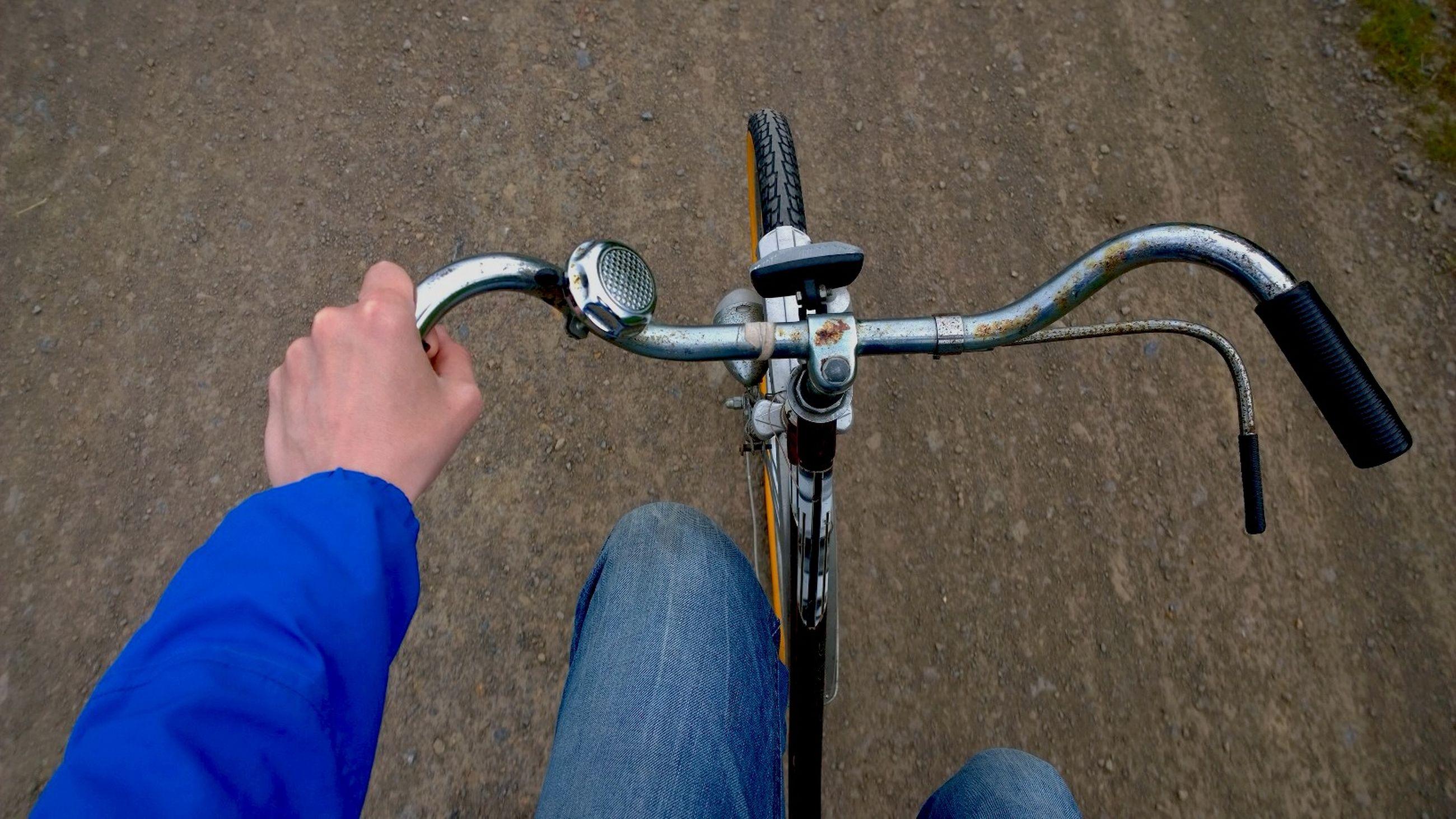 Hand of cyclist on handlebar