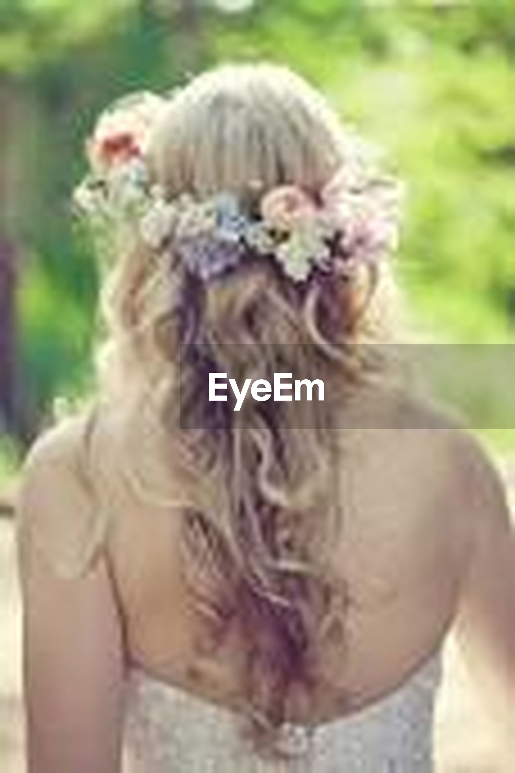 focus on foreground, close-up, headshot, person, lifestyles, animal themes, leisure activity, day, rear view, outdoors, field, park - man made space, long hair, flower, girls, one animal, nature, young women