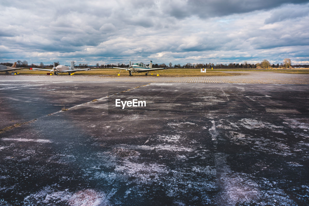 cloud - sky, sky, airport, nature, airport runway, day, transportation, airplane, air vehicle, environment, no people, landscape, travel, outdoors, runway, airfield, architecture, mode of transportation, scenics - nature, aerospace industry