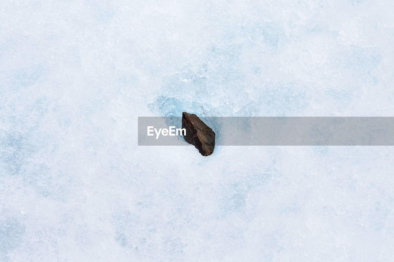High Angle View Of Stone On Ice