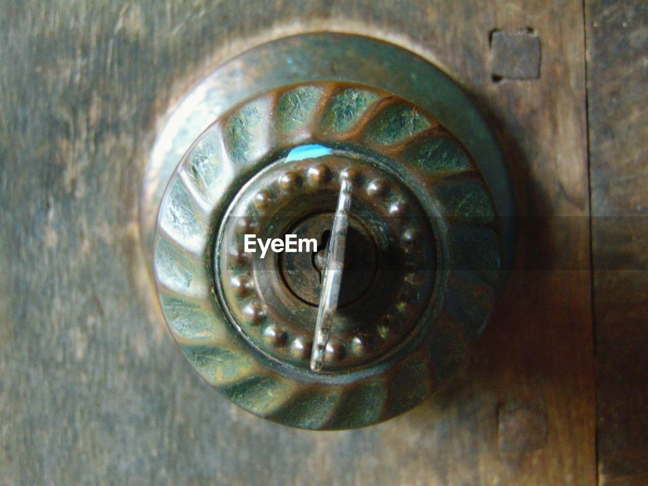 CLOSE-UP OF METALLIC DOOR