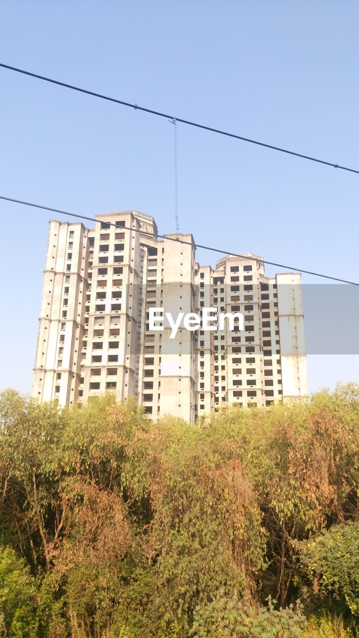 architecture, growth, city, cable, skyscraper, no people, low angle view, tree, building exterior, built structure, clear sky, outdoors, day