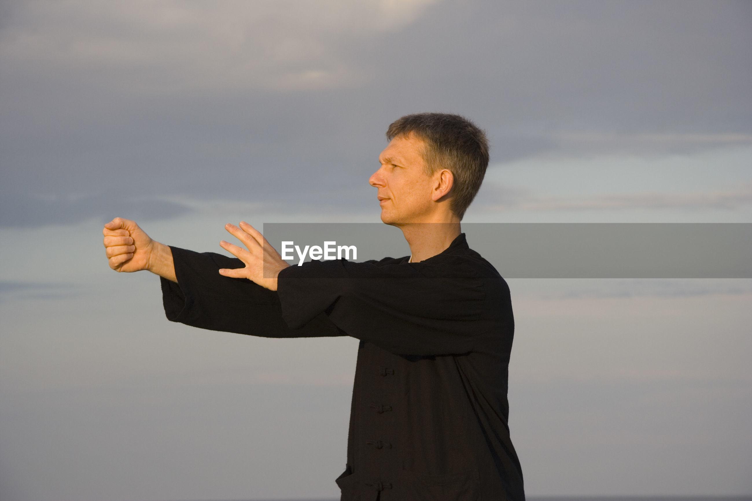 Close-up of a man practicing tai chi