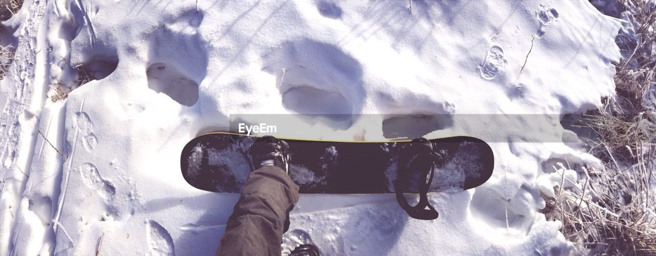 Low section of person snowboarding