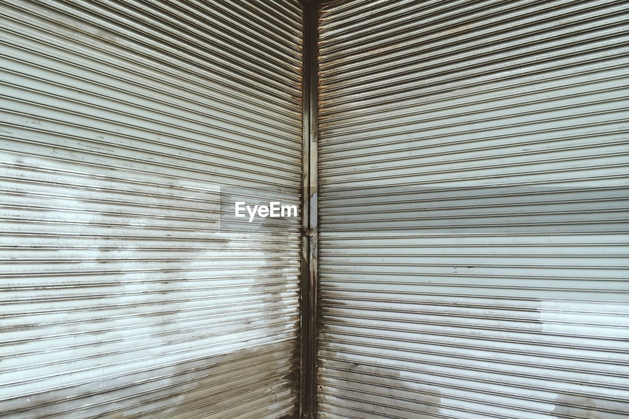 Full Frame Shot Of Metallic Garage Shutters