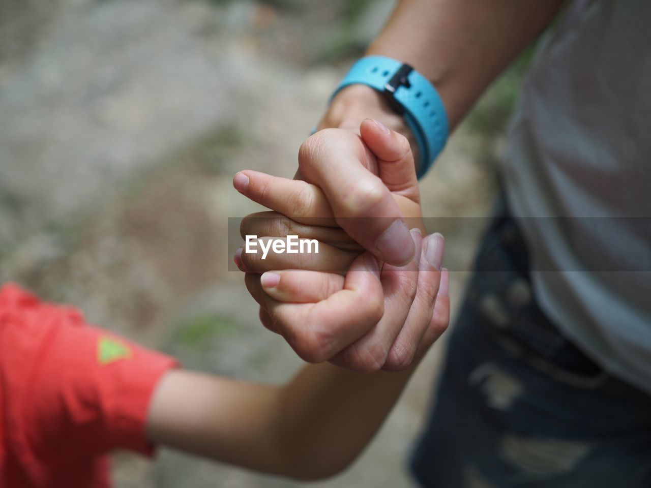human hand, hand, real people, human body part, child, childhood, people, holding, lifestyles, selective focus, focus on foreground, two people, day, men, finger, human finger, togetherness, boys, midsection, body part, innocence