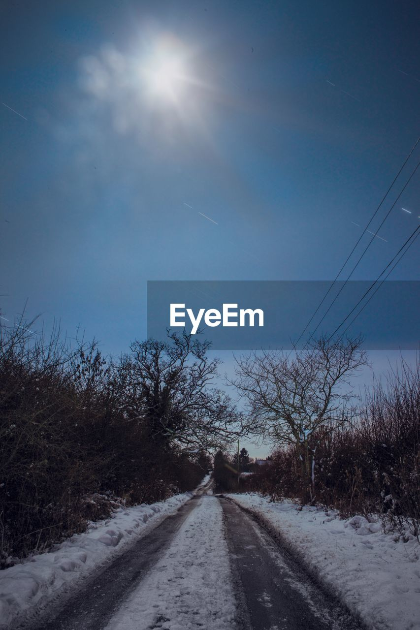 sky, sun, the way forward, nature, road, snow, no people, outdoors, day, tree, beauty in nature, landscape, clear sky, scenics, bare tree
