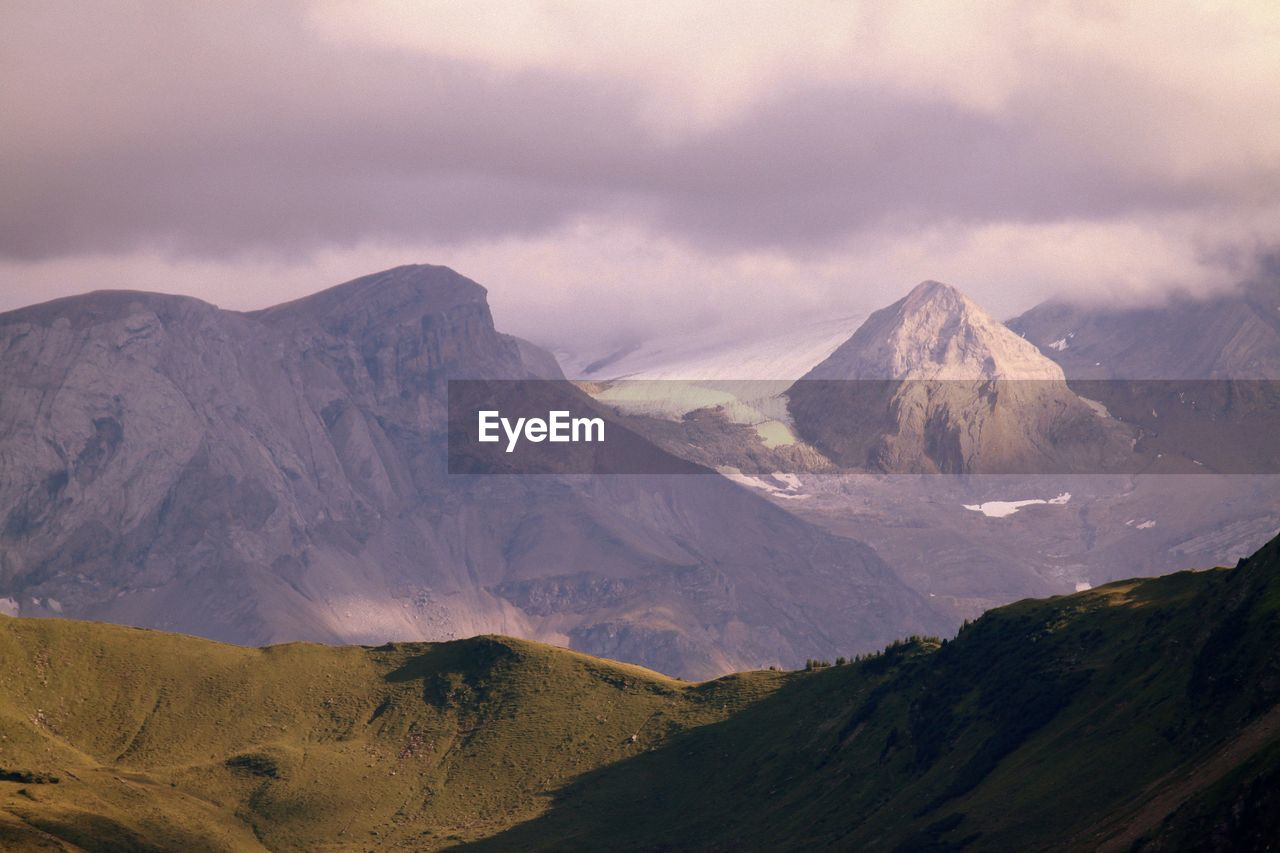 SCENIC VIEW OF MOUNTAINS AGAINST THE SKY