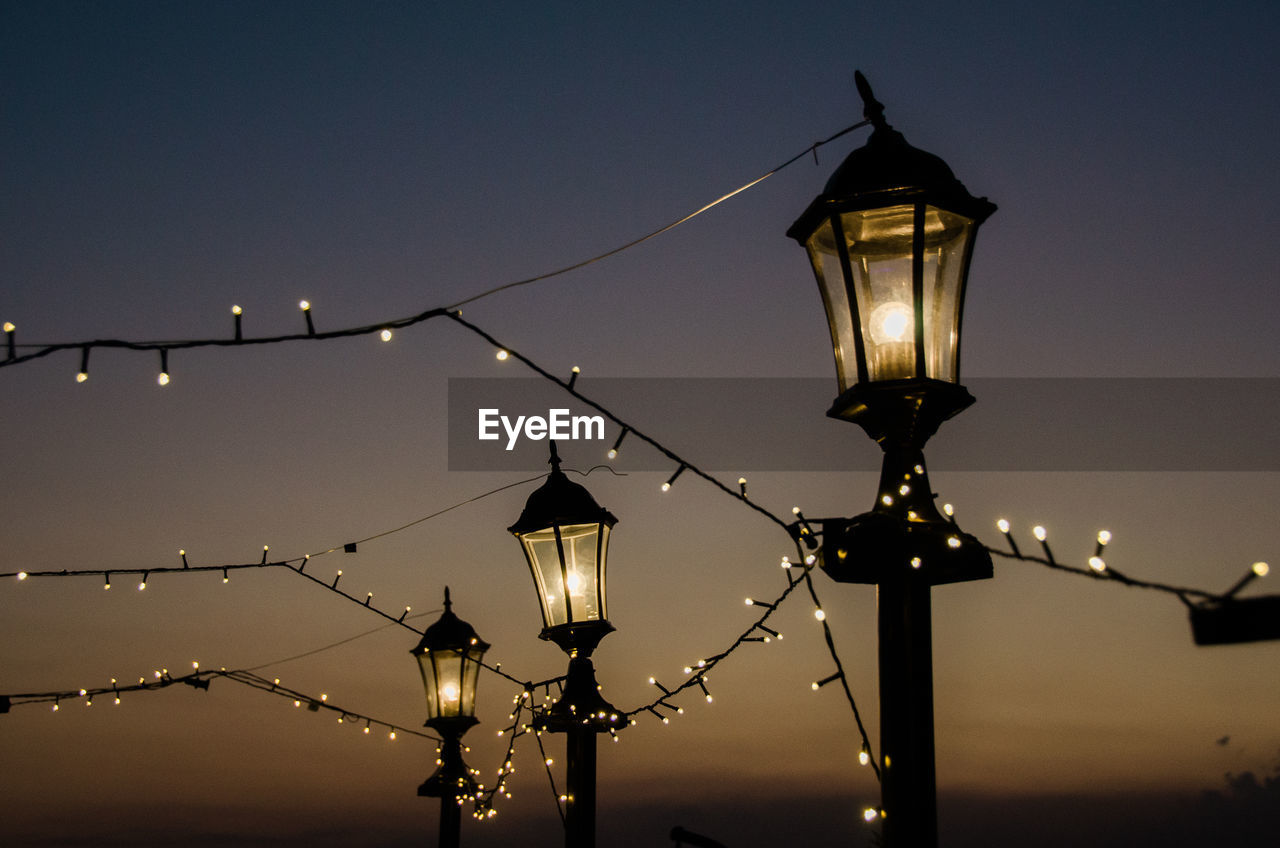 lighting equipment, illuminated, street light, electricity, electric light, gas light, street lamp, electric lamp, low angle view, outdoors, dusk, no people, night, sky, lantern, light bulb, sunset, close-up