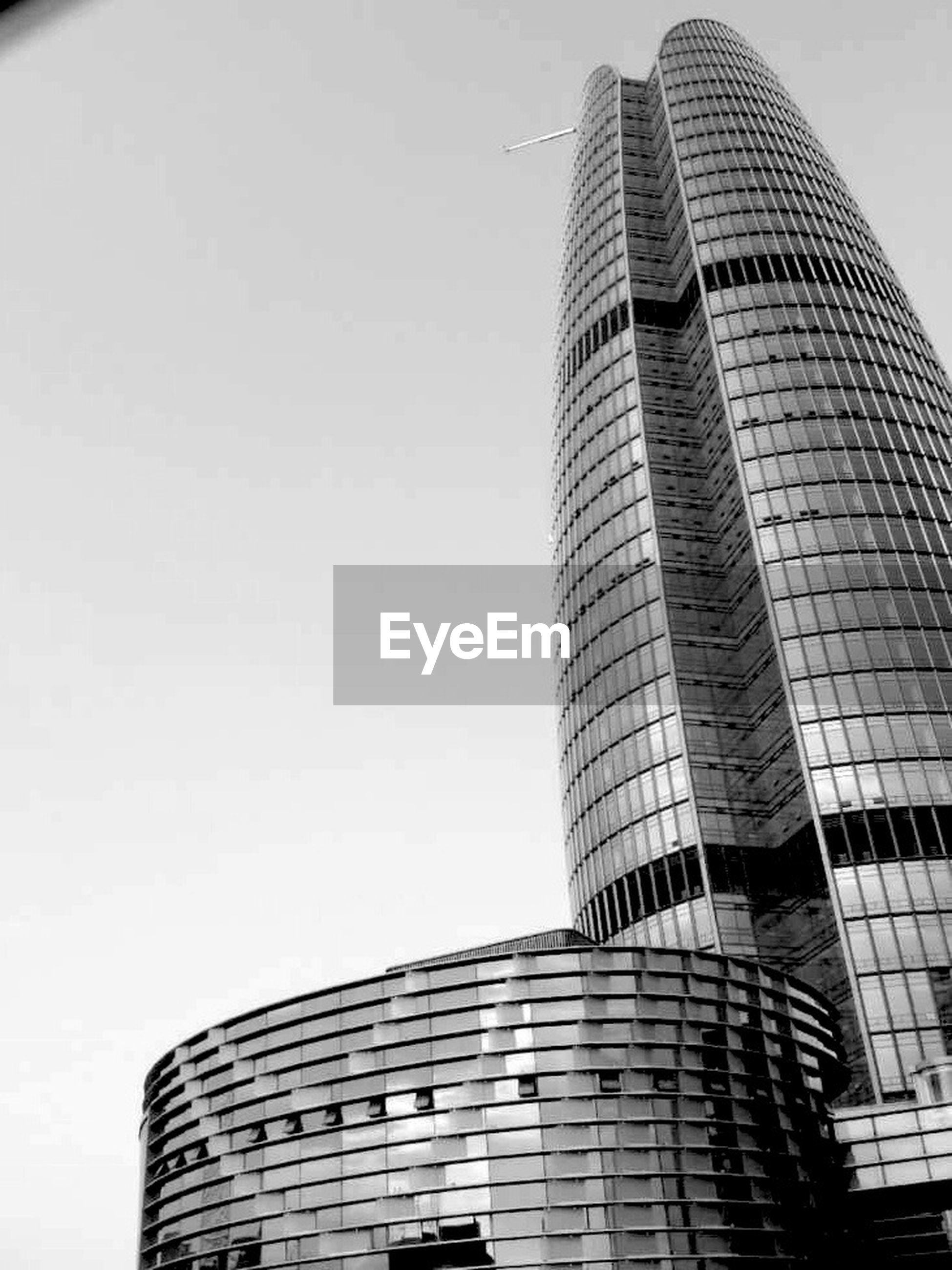 building exterior, architecture, built structure, skyscraper, low angle view, tall - high, modern, office building, tower, city, clear sky, building, tall, copy space, sky, day, outdoors, glass - material, city life, no people