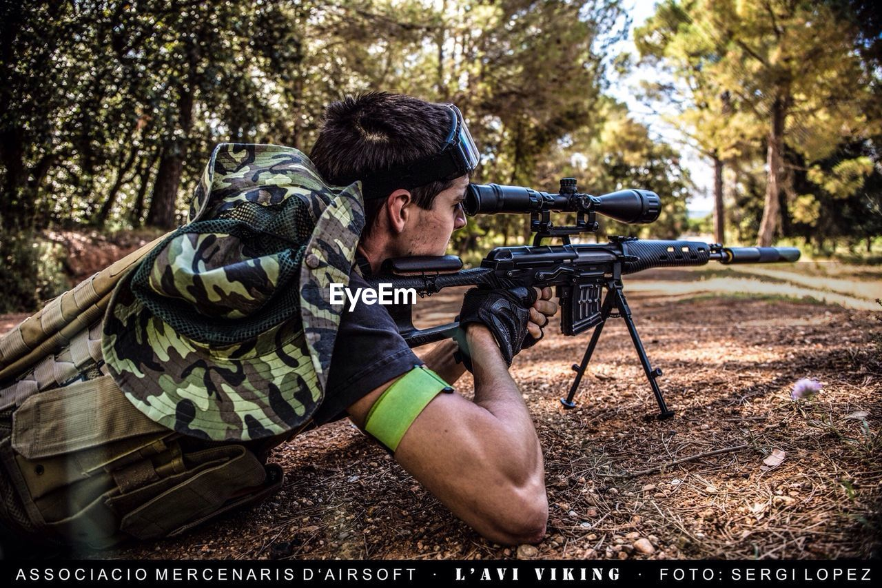 gun, forest, weapon, tree, real people, protection, men, rifle, one person, outdoors, day, shooting a weapon, military, adult, one man only, young adult, nature, only men, people, adults only, camouflage clothing