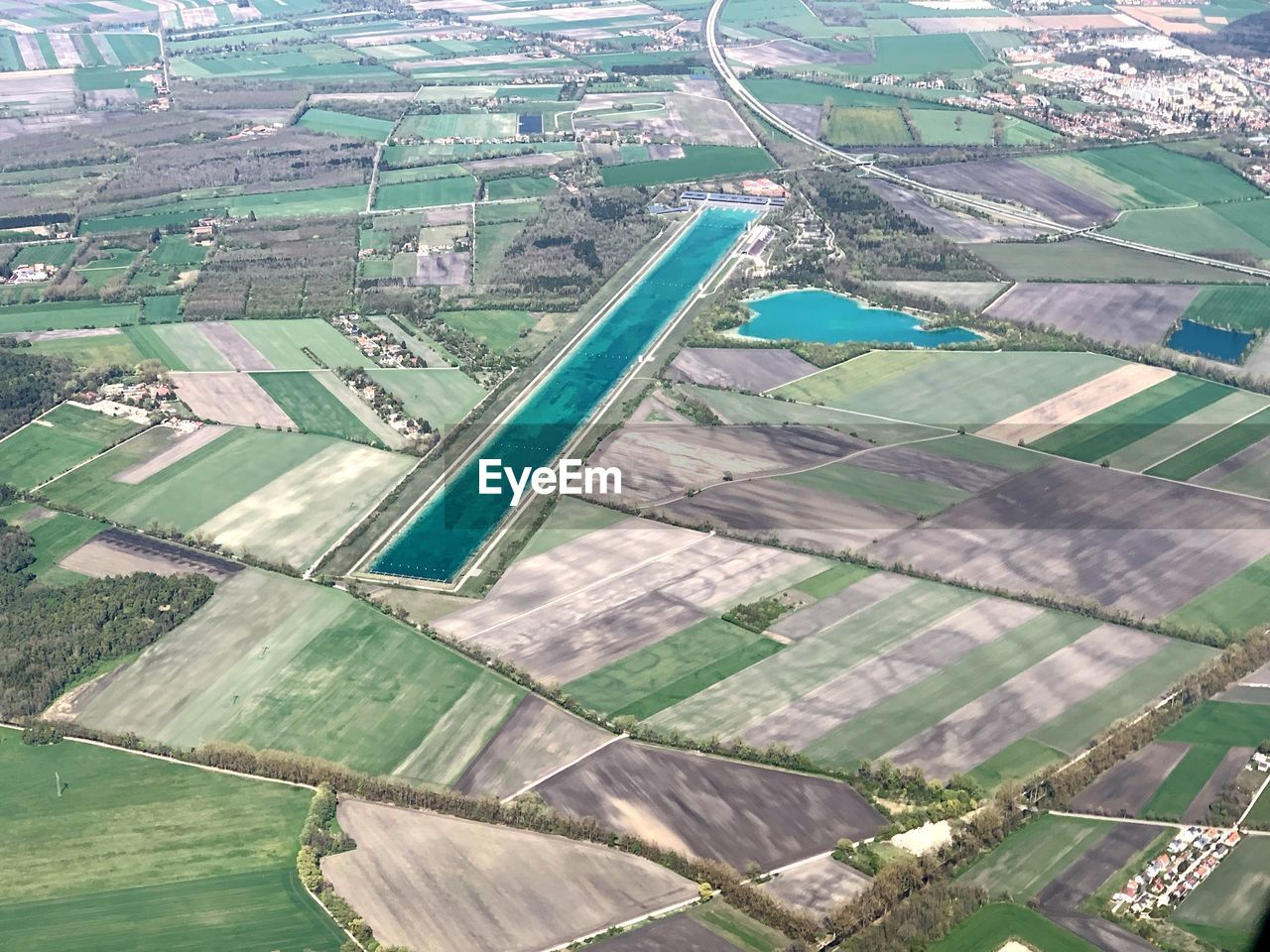 aerial view, water, environment, landscape, agriculture, scenics - nature, patchwork landscape, day, beauty in nature, nature, field, land, rural scene, tranquil scene, no people, tranquility, farm, outdoors, high angle view, swimming pool