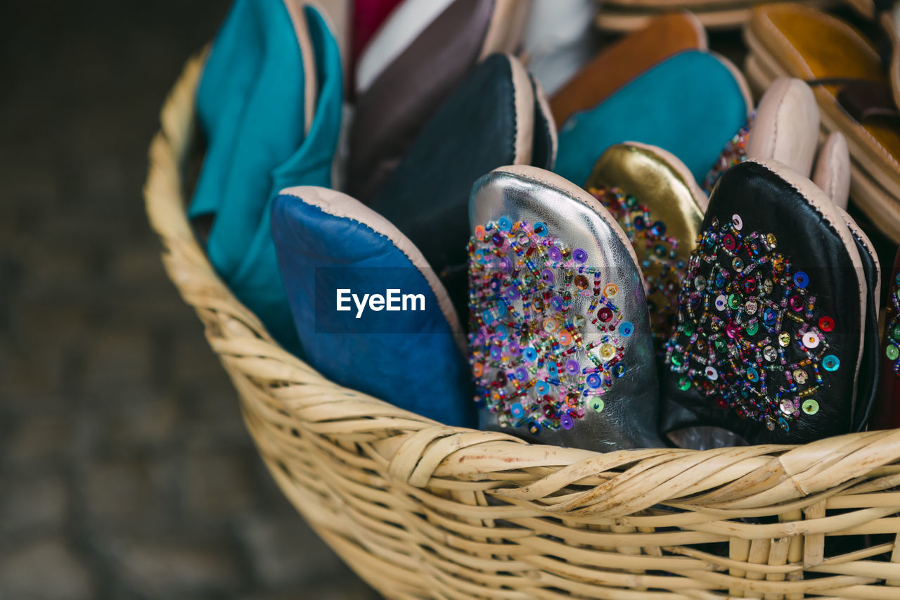 Close-up of shoes in wicker basket for sale in market