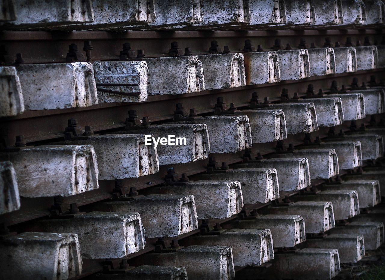 full frame, backgrounds, no people, in a row, repetition, pattern, architecture, large group of objects, day, order, textured, close-up, wall, stack, arrangement, built structure, outdoors, wood - material, side by side