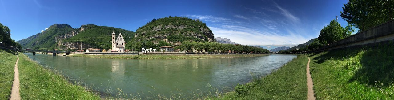 water, sky, plant, nature, scenics - nature, mountain, beauty in nature, tree, day, architecture, no people, built structure, tranquility, tranquil scene, transportation, river, grass, panoramic, green color, outdoors