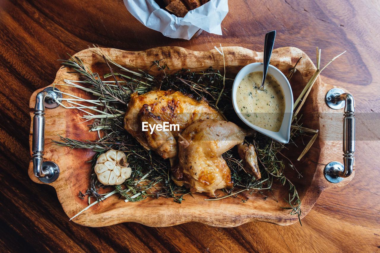 High angle view of chicken with dip served on table
