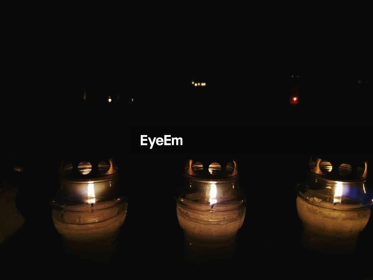 flame, candle, burning, illuminated, heat - temperature, tea light, glowing, darkroom, no people, indoors, night, close-up, black background