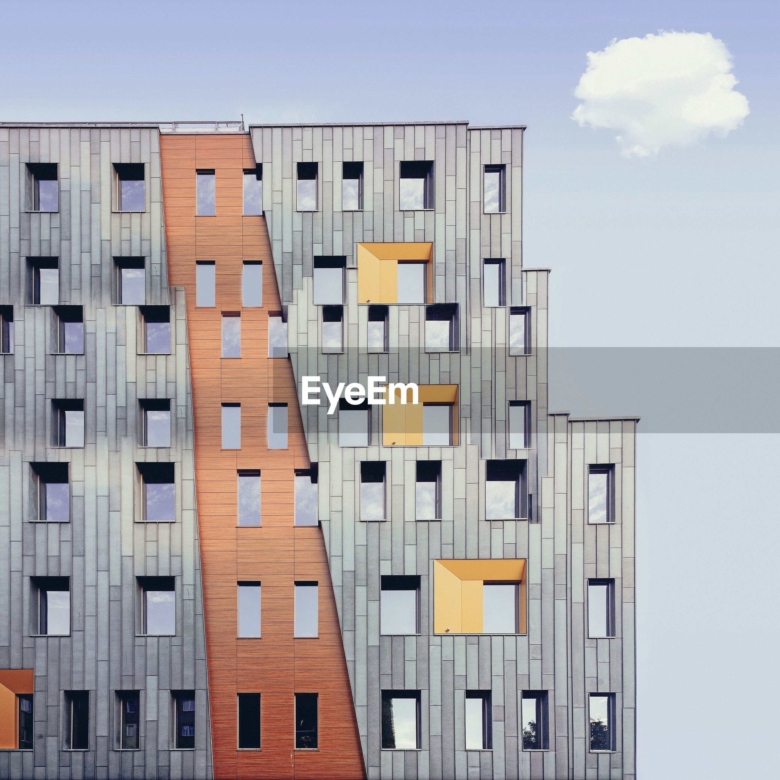 LOW ANGLE VIEW OF BUILDINGS AGAINST THE SKY