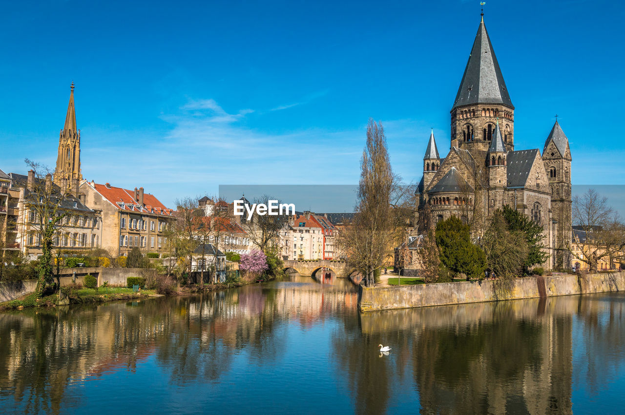 architecture, built structure, building, building exterior, water, sky, history, the past, religion, place of worship, reflection, nature, belief, travel destinations, spirituality, blue, old, waterfront, no people, outdoors, canal, spire
