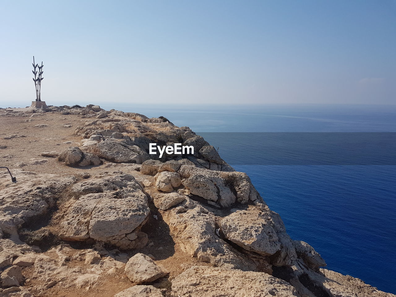 sea, horizon over water, nature, tranquil scene, water, beauty in nature, scenics, tranquility, rock - object, outdoors, day, clear sky, sky, no people, beach