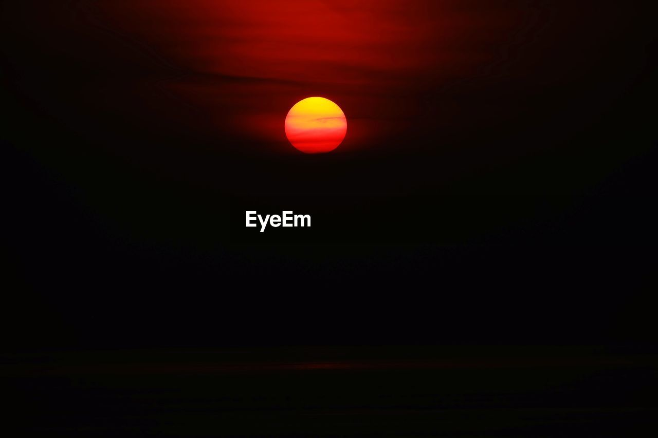 beauty in nature, sky, no people, copy space, scenics - nature, night, space, tranquility, nature, tranquil scene, eclipse, red, astronomy, low angle view, dark, natural phenomenon, outdoors, solar eclipse, majestic