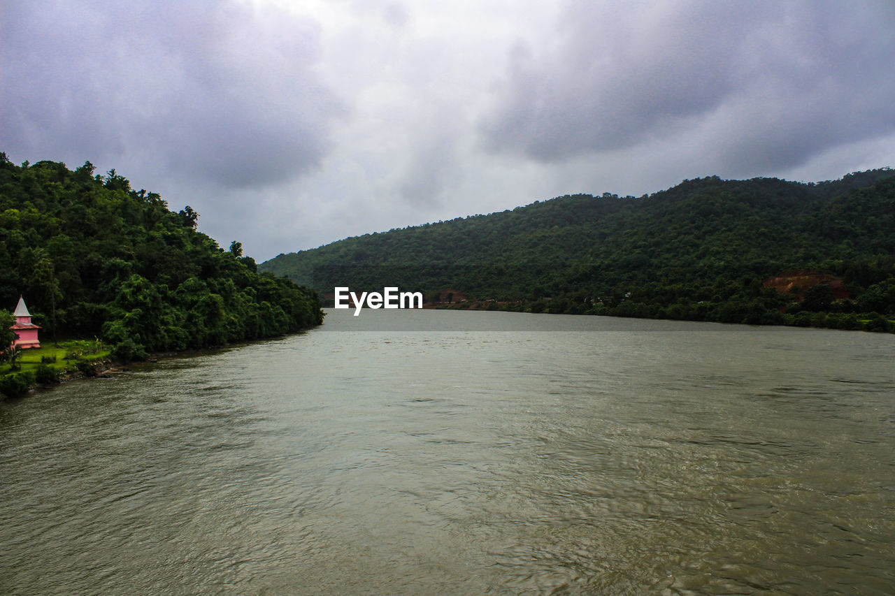 sky, cloud - sky, water, beauty in nature, mountain, waterfront, nature, tree, scenics - nature, tranquility, plant, environment, tranquil scene, river, day, no people, overcast, non-urban scene, outdoors