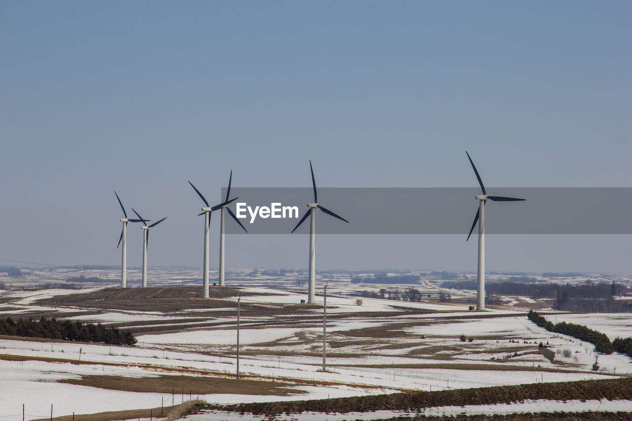 environment, fuel and power generation, environmental conservation, turbine, wind turbine, renewable energy, snow, alternative energy, wind power, sky, winter, cold temperature, nature, field, day, landscape, clear sky, beauty in nature, land, no people, outdoors, sustainable resources