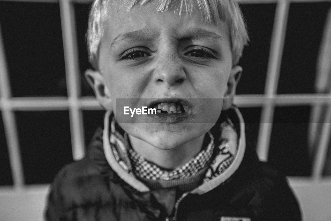 Portrait of boy clenching teeth