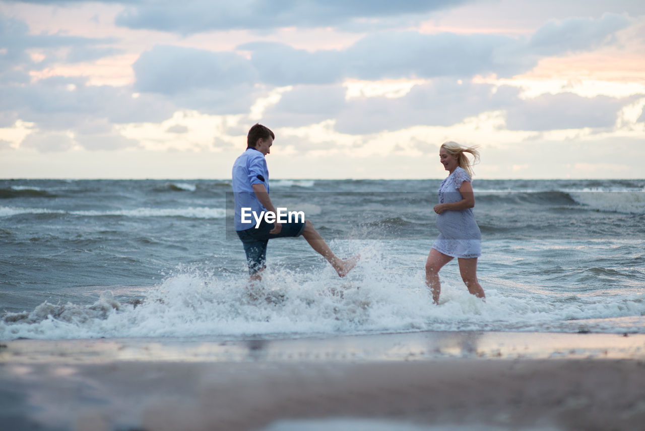water, sky, sea, motion, beach, child, men, leisure activity, land, cloud - sky, two people, boys, males, togetherness, real people, nature, childhood, horizon, people, horizon over water, outdoors, positive emotion